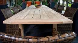 Teak table with resin wicker chairs.